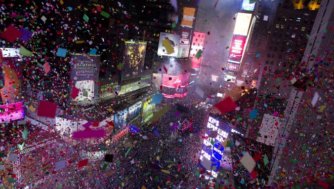Confetti flies over Times Square in New York in 2014 as the new year is celebrated.