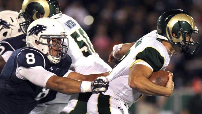 Oct 11, 2014: Nevada's Ian Seau (8) sacks Colorado State quarterback Garrett Grayson (10) in the first quarter of their game at MacKay Stadium.