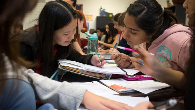 Kiri Carlson (left) and Saleenjit Kang work on a problem, Jan. 5, 2016, in their History of Math class at Basis Scottsdale, 11440 N. 136th St., Scottsdale.