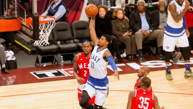 Eastern Conference's Paul George, of the Indiana Pacers, (13) scores on the Western Conference's defense during first half NBA All-Star Game basketball action in Toronto on Sunday, Feb. 14, 2016. (Chris Young/The Canadian Press via AP) MANDATORY CREDIT