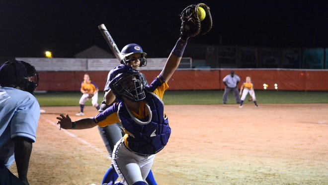 Byrd catcher Shelby Hodge hauls in an errant throw during Tuesday's game with Evangel. Byrd won the slugfest 9-8.