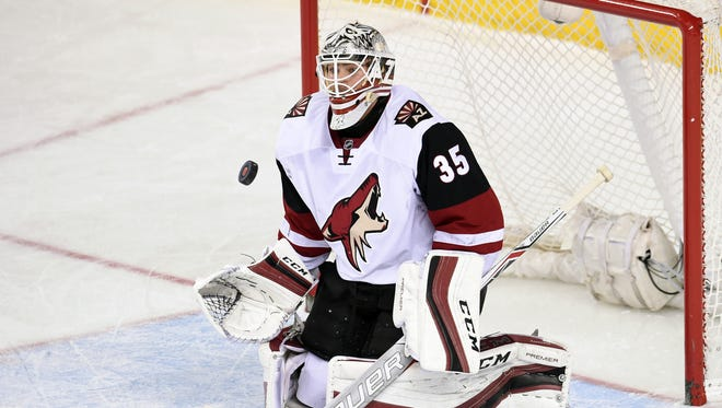 Mar 11, 2016: Arizona Coyotes goalie Louis Domingue (35) stops a shot from the Calgary Flames at Scotiabank Saddledome. Coyotes won 4-1.