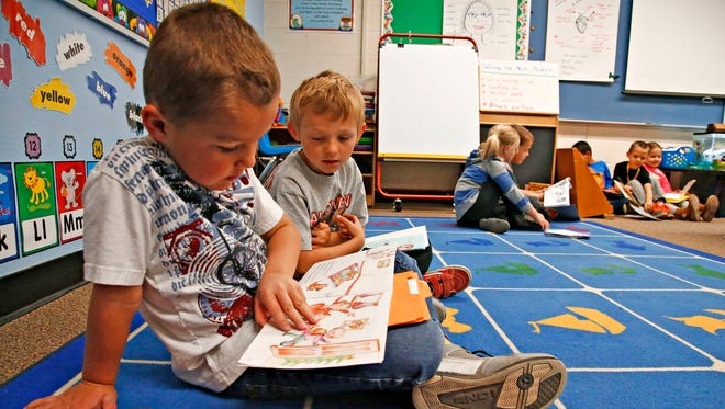 Kalon Hall and Wyatt Walters practice reading aloud to each other in Amy Trujillo's accelerated kindergarten class at Apache Elementary School in Peoria on February 4, 2016.