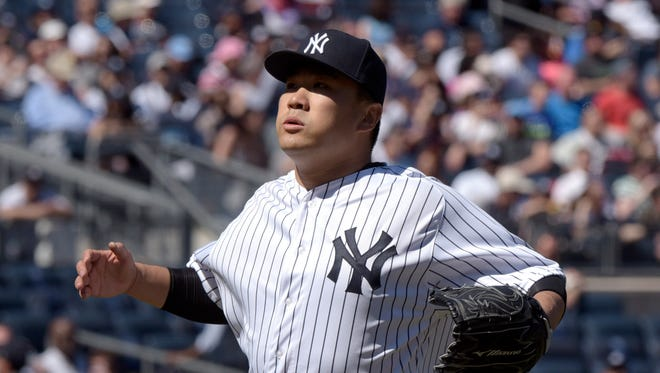 New York Yankees pitcher Masahiro Tanaka reacts at the end of the fifth inning after allowing the Seattle Mariners to score a run in a baseball game Sunday, April 17, 2016, at Yankee Stadium in New York.