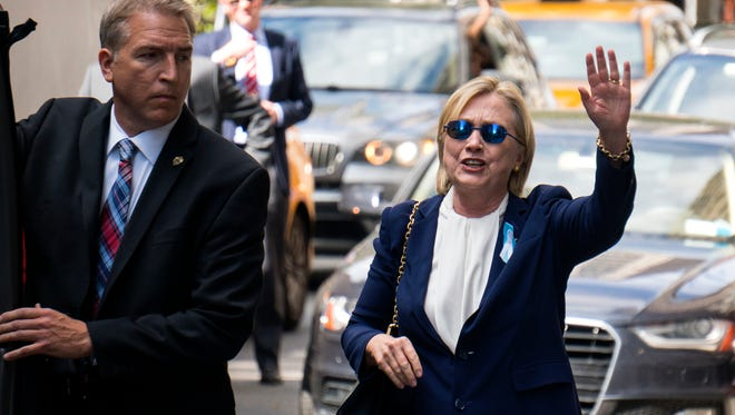 "Democratic presidential candidate Hillary Clinton walks from her daughter's apartment building Sunday, Sept. 11, 2016, in New York. Clinton unexpectedly left Sunday's 9/11 anniversary ceremony in New York after feeling ""overheated,"" according to her campaign."