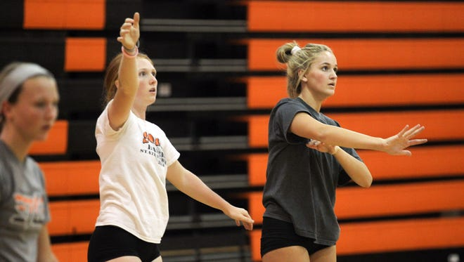 Solon outside hitters Jessica Heick, left, and Grace Keith, are hoping to lead the Spartans on a midseason surge after beginning the year 5-11.