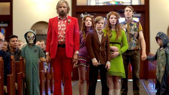 "Shree Crooks, Viggo Mortensen, Samantha Isler, Nicholas Hamilton, Annalise Basso, George MacKay and Charlie Shotwell appear in a scene from ""Captain Fantastic."""