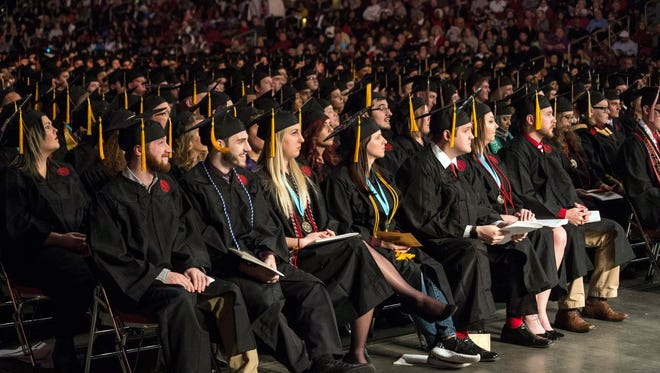 Close to 900 graduates participated in the University of Louisville's winter commencement ceremony at the KFC Yum Center on Thursday night. 12/15/16