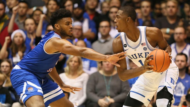 Harry Giles drives the ball against Tennessee State forward Ken'Darrius Hamilton.