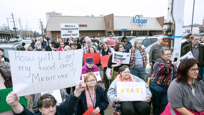 Makeshift signs peppered the landscape during a rally at the Old Louisville Kroger on Second Street as the neighborhood prepares for the announced departure of the food chain. 1/21/17