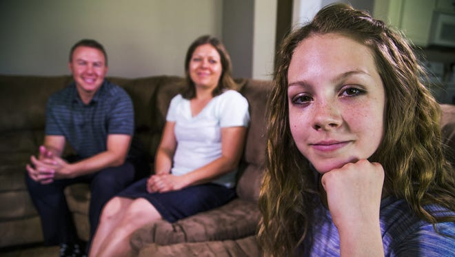 Queen Creek Middle School student Olivia Vella, 13, wrote a special poem in class about self-doubt. The video of her performing the poem in class has gone viral. Her mom, Molly Vella, and teacher Brett Cornelius (back right and left) are both very proud of her, but also sad that Olivia feels the way she does.