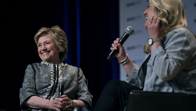 Hillary Clinton with author and moderator Cheryl Strayed in New York.