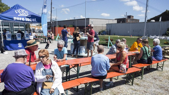 Curious fans of organic food lined picnic tables at ReSurfaced on Saturday afternoon for the Courier-Journal's FEAST O.F.F. 9/3/16