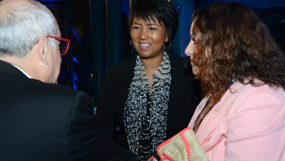 Astronaut Mae Jemison talks with guests during the