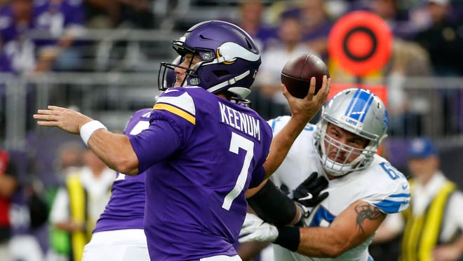 Minnesota Vikings quarterback Case Keenum (7) throws a pass during the first half of an NFL football game against the Detroit Lions, Sunday, Oct. 1, 2017, in Minneapolis.