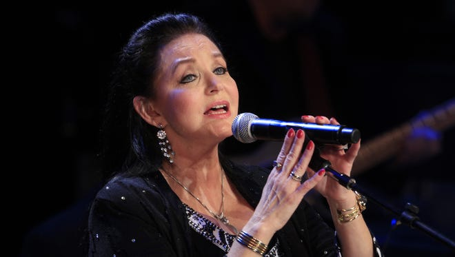 In this Oct. 21, 2012 file photo, Crystal Gayle performs at the Country Music Hall of Fame Inductions in Nashville, Tenn.