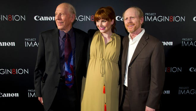Actor Rance Howard, left, who died Saturday, appears at a 2011 movie premiere with his granddaughter, actress Bryce Dallas Howard, and his son, director Ron Howard.