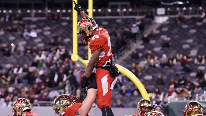 Non-Public Group 4 state football final at MetLife Stadium in East Rutherford, on Friday, December 01, 2017.  BC #25 Rahmir Johnson celebrates after scoring a touchdown in the first quarter.