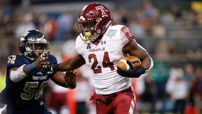 Temple running back David Hood evades FIU linebacker Treyvon Williams during the first quarter on Thursday.