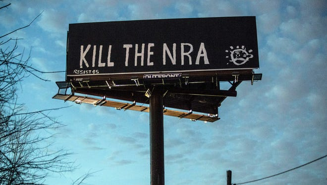 "A billboard along I-65 North near Fern Valley Road on Monday was vandalized with the message ""Kill the NRA""."