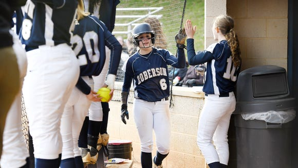 Roberson freshman Taylor Stingel is congratulated by