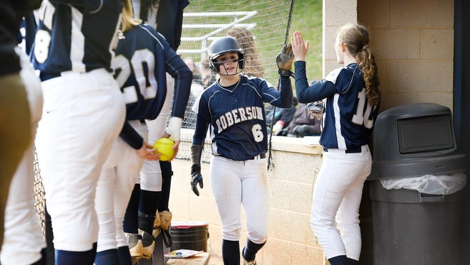 Roberson freshman Taylor Stingel is congratulated by teammate Amala Clawson after scoring a run during a game against Asheville on Tuesday, March 27, 2018.