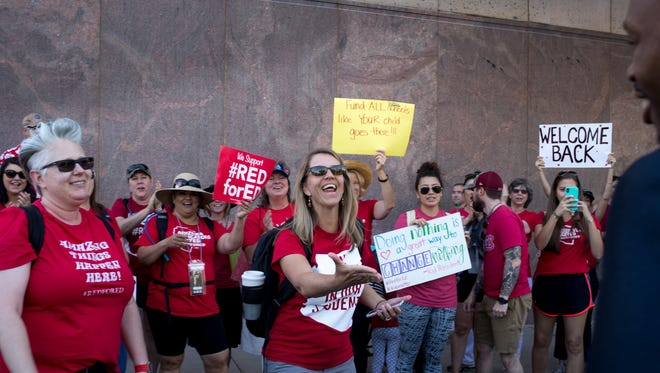 State Rep. Reginald Bolding is greeted by #RedForEd supporters at the Arizona Capitol in Phoenix on April 30, 2108, the third day of the Arizona teacher walkout.