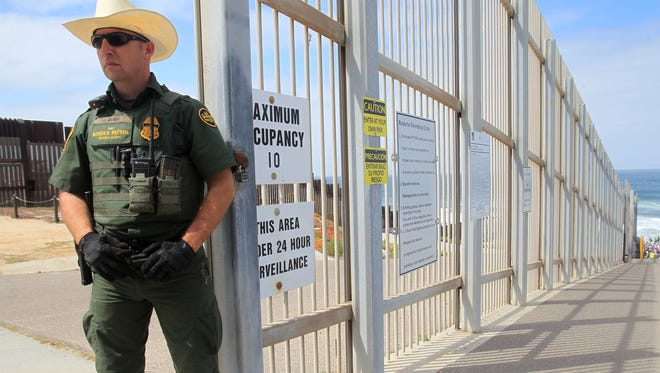 A Border Patrol officer guards the entrance to Friendship Park along the southwest border with Mexico on April 29, 2018, in San Diego, Calif.
