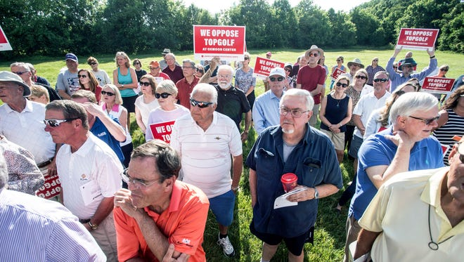 A group called Louisville Neighbors for Responsible Growth held a rally near the intersection of Oxmoor Woods Parkway and Lyndon Lane on Wednesday afternoon to voice opposition to the building of a Topgolf complex at Oxmoor Center. 5/23/18