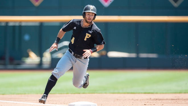 Purdue's Skyler Hunter rounds third base and scores on Jacson McGowan's first-inning double.