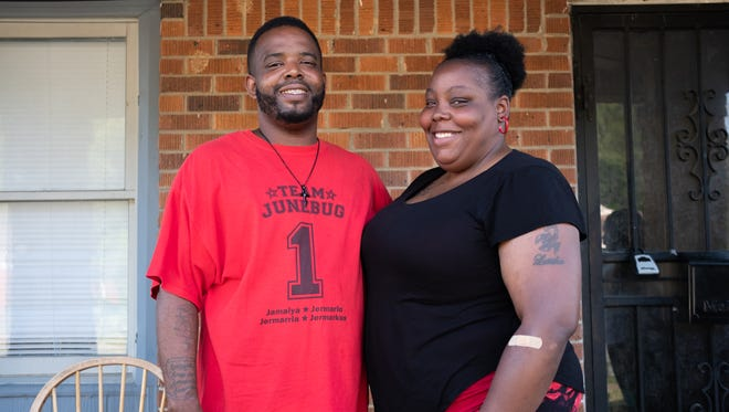 Jermar and Latisha Wilkins, who have been married since May 5, on the front porch of their home.