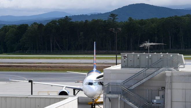 An Allegiant Airlines plane waits at a gate at the Asheville Regional Airport on Tuesday, June 12, 2018.