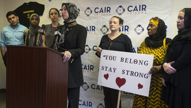 Suzanne Bassal (center) speaks during a press conference on June 26, 2018, at CAIR-Arizona in Mesa. The groups discussed the Supreme Court's ruling on the travel ban and how it supports Islamaphobia.
