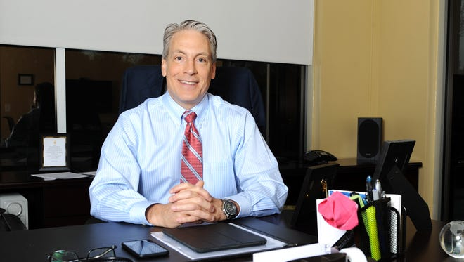 Mission Health CEO Dr. Ron Paulus is leading the not-for-profit company in the biggest change in its history. He sits in his office at the Mission Health corporate headquarters near Hendersonville Road.