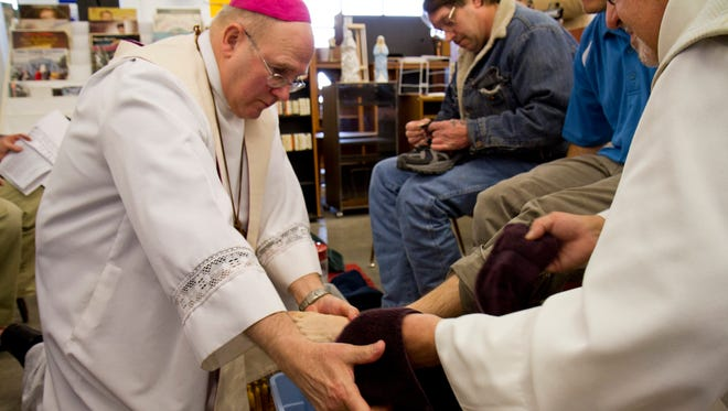 """Bishop Michael Warfel said he was """"taking a page out of the pope's book"""" this Holy Thursday and visiting several places around the community to wash the feet of community members. Pope Francis also marked the day by washing feet."""