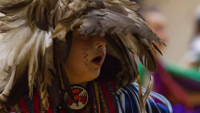 Six-year-old Cordiero Houle, a dancer with the Longfellow School Indian Culture Club, performs in Augusta as part of a cultural exchange trip.