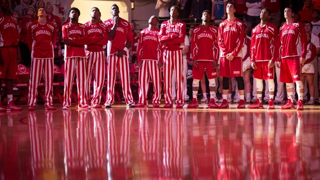Indiana players watch a video during Hoosier Hysteria on Oct. 25, 2014, at Assembly Hall in Bloomington.