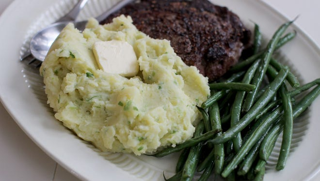 Mashed potatoes flecked with scallions and topped with butter in Concord, N.H. on Feb. 2, 2015.