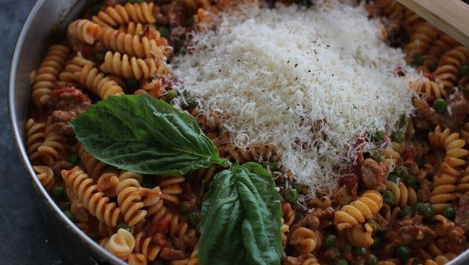 Fusilli with Italian sausage, peas and creamy tomato sauce.