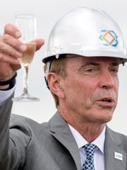 Craig Bouchard, chairman and CEO of Braidy Industries, offers a toast Friday, May 31, 2018, during a groundbreaking ceremony for Braidy Industries' 2.5 million square-foot, fully integrated aluminum rolling mill in Greenup, Ky.