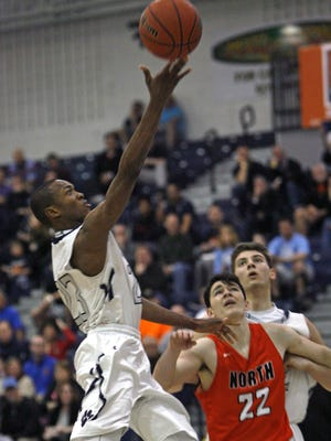 Ranney School's Scottie Lewis, left, shoots as Middletown North Chris Kenny (22) and Ranney School's Chris Autino watch the play in the SCT quarterfinal at Toms River North High School Feb. 19, 2017. Photo by Vincent DiSalvio / Special to The ASBURY PARK PRESS