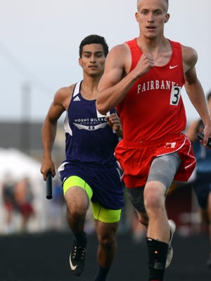 Mount Gilead's Deondre Cook runs, left, the anchor leg of the boys 1600 meter relay Friday night, May 27, 2016, at the Division III Regional Track and Field Field Finals at Fairfield Union High School in Rushville. Cook overtook Fairbanks' Alex Cochrane to win the race for the Indians.