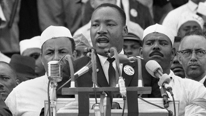 """FILE- In this Aug. 28, 1963, black-and-white file photo Dr. Martin Luther King Jr., head of the Southern Christian Leadership Conference, addresses marchers during his """"I Have a Dream"""" speech at the Lincoln Memorial in Washington. NBC News says it will rebroadcast a 1963 """"Meet the Press"""" interview with Martin Luther King Jr. in honor of the March on Washington's 50th anniversary next week. King appeared on the news program three days before his landmark """"I Have a Dream"""" speech at the civil rights march."""