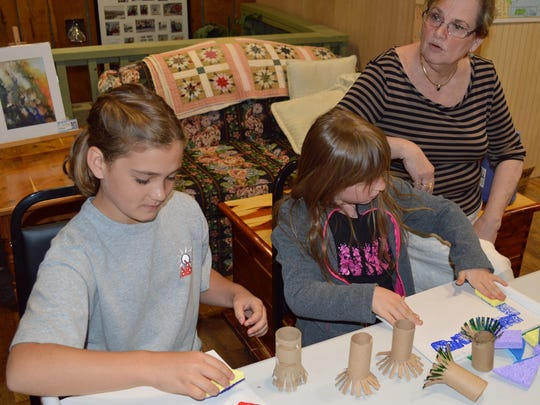Calico Rock School students use sponges and cardboard