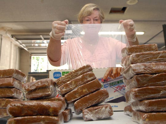 Susan Walden, 65, of Gardnerville, wraps up hunks of fudge for the Genoa Candy Dance Arts & Crafts Faire. The annual event takes place Sept. 24-25, 2016.