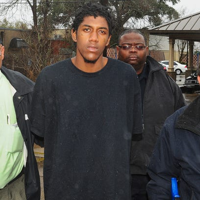 Opelousas city marshals escort Theobegi Levier to the city jail after his arrest Wednesday in Ville Platte.