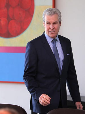 Macy's CEO Terry Lundgren arrives at a press conference at the company's Downtown office following a shareholders meeting.