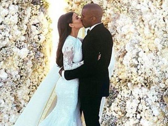 Kanye West and Kim Kardashian at their wedding