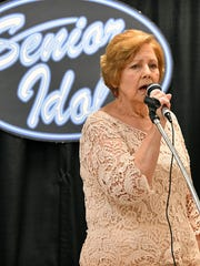 "Lucille Roberts sings ""Unchained Melody"" performing in the 8th Annual Senior Idol talent show Friday morning at The Kitchen. Ron Kingcade took first place in the contest singing ""Can't Help Falling in Love with You."""