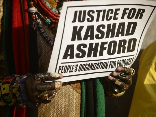 A sign at a press conference after the fatal shooting of Kashad Ashford by police.